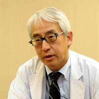 Cautiously optimistic: Haruhiko Sago, head of the Center for Maternal-Fetal and Neonatal Medicine at the National Center for Child Health and Development, is interviewed in Tokyo's Setagaya Ward on March 12. | SATOKO KAWASAKI