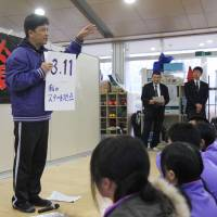 Education is key:  Toshiro Sato, a teacher at Onagawa No. 1 Junior High School on the coast of Miyagi Prefecture, instructs students to come up with '3.11 messages' during an assembly on disaster prevention Feb. 15. | KYODO