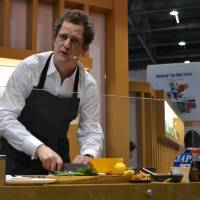 Cooking up contacts: British chef Valentine Warner participates in a cooking demonstration at an international food and drink trade exhibition in London on March 18. | KYODO