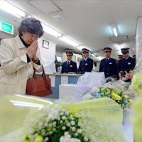 Widow's prayer: Shizue Takahashi, who lost her husband in the 1995 sarin gas attack on the Tokyo subway system, prays before an altar at Kasumigaseki Station in Chiyoda Ward during a ceremony Wednesday morning. The attack by Aum Shinrikyo 18 years ago killed 13 people and wounded more than 6,000.  | KYODO