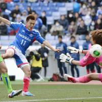 Off to a good start: Yokohama F. Marinos forward Manabu Saito (11) scores a goal in the 83rd minute against Shonan Bellmare on Saturday at Nissan Stadium on the opening day of the J. League. F. Marinos won 4-2. | KYODO