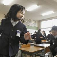 School's in: A third-grader runs around in a room at the Fukushima No. 3 Elementary School in the city of Fukushima on Wednesday. The school kicked off a new semester the same day. | KYODO