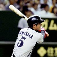 Hanshin pinch hitter Osamu Hamanaka hits an RBI double in the fifth inning against the Yomiuri Giants on Wednesday at Tokyo Dome. | KYODO PHOTO