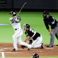 Hokkaido Nippon Ham's Hichori Morimoto rips a two-run double in the second inning against Chiba Lotte on Saturday afternoon in Game 1 of Stage 2 of the Pacific League Climax Series at Sapporo Dome. The Fighters won 5-2. | KYODO PHOTO