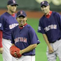 Boston Red Sox pitcher Daisuke Matsuzaka laughs during a Boston workout on Monday at Tokyo Dome. | AP PHOTO