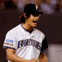 Nippon Ham's Yu Darvish reacts after forcing Tohoku Rakuten's Takeshi Yamasaki to hit into a double play in the seventh inning at Sapporo Dome on Thursday. Darvish notched his second shutout game of the season with a 1-0 win over the Golden Eagles. | KYODO PHOTO
