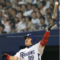 Milestone: Norihiro Nakamura of the Chunichi Dragons hits his 350th career home run, a two-run shot, in the eighth inning against the Nippon Ham Fighters on Saturday at Nagoya Dome. The Dragons won 4-1. | KYODO PHOTO