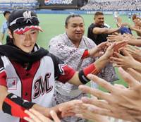 Victorious interaction: Tsuyoshi Nishioka (far left) reacts with fans, along with Benny Agbayani (far right) and ozeki Chiyotaikai after the Marines' 10-6 victory on Saturday. | KYODO PHOTO