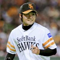 Flying high: Toshiya Sugiuchi, who leads Japanese baseball in strikeouts and is tied for the lead in complete games, is one-third of a trio of lefty starters for the Fukuoka Softbank Hawks. | KYODO PHOTO