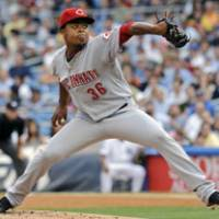 Rock and fire: Cincinnati's Edinson Volquez delivers a pitch during the first inning against the Yankees on Friday night. | AP PHOTO