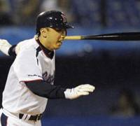 Decisive hit: Yakult Swallows third baseman Shinya Miyamoto hits an infield single for the winning run in the fifth inning against the Orix Buffaloes on Saturday at Jingu Stadium. The Swallows won 4-2. | KYODO PHOTO