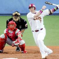 Clutch hit: Pinch hitter Takeshi Yamasaki of the Tohoku Rakuten Golden Eagles hits a 'sayonara' RBI single to right in the bottom of the ninth inning at Kyocera Dome in Game 1 of the All-Star Series on Thursday. The Pacific League All-Stars won 5-4. | KYODO PHOTO