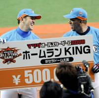 Share the prize: Seibu Lions slugger G.G. Sato (left) poses with Tuffy Rhodes of the Orix Buffaloes after the two won the home run derby before Thursday's All-Star Series opener. | KYODO PHOTO