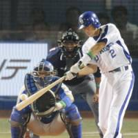 Getting revenge: Masahiro Araki of the Chunichi Dragons hits a two-run, bases-loaded single in the fourth inning in Game 2 of the NPB All-Star Series at Yokohama Stadium on Friday. All-Central beat All-Pacific 11-6 to avenge Thursday's loss. | KYODO PHOTO