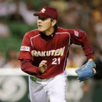 Flying high: Tohoku Rakuten pitcher Hisashi Iwakuma, who leads Japanese baseball with an 18-3 record, is having a career year in 2008 for the Golden Eagles. | KYODO PHOTO