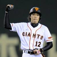 Pumped up: Yomiuri outfielder Takahiro Suzuki reacts after hitting a two-run double that put his team ahead in the fifth inning against the Tigers at Tokyo Dome on Sunday.   KYODO PHOTO