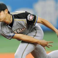 All for Yu: Hokkaido Nippon Ham Fighters' Yu Darvish tosses a pitch against the Orix Buffaloes during his team's 4-1 win in Game 1 of the first stage of the Pacific League Climax Series at Osaka Dome on Saturday.   KYODO PHOTO