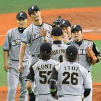 Job well done: Pitcher Yu Darvish (second from back) led the Hokkaido Nippon Ham Fighters to Saturday's 4-1 win over the Orix Buffaloes. | KYODO PHOTO