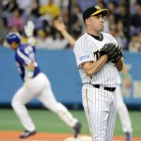 What could have been: Hanshin Tigers reliever Scott Atchinson reflects on giving up a solo home run to Masahiko Morino of the Chunichi Dragons in the sixth inning of Saturday's Game 1 of the first stage of the Central League Climax Series at Kyocera Dome. The Dragons won the game 2-0. | KYODO PHOTO