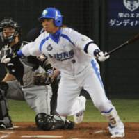 Checkmate: Seibu Lions shortstop Hiroyuki Nakajima hits an RBI single to right in the first inning of Game 4 of the second stage of the Pacific League Climax Series against the Nippon Ham Fighters. The Lions won 9-4 and need one win to advance to the Japan Series. | KYODO PHOTO