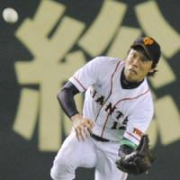 Good catch: Yomiuri center fielder Takahiro Suzuki catches a flyball hit by Chunichi's Masahiko Morino in the seventh inning of the second-stage opener of the Central League Climax Series on Wednesday at Tokyo Dome. | KYODO PHOTO