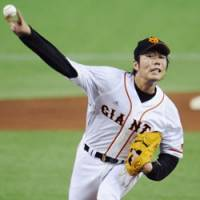 Solid performance: Yomiuri Giants pitcher Koji Uehara releases the ball against the Chunichi Dragons in his start in Thursday's Game 2 of the second stage of the Central League Climax Series. Uehara hurled a four-hitter over eight innings in the Giants' 11-2 rout.   KYODO PHOTOS