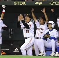 Season continues: Yomiuri manager Tatsunori Hara (88) and his Giants celebrate Alex Ramirez's tiebreaking two-run homer in the second inning at Tokyo Dome on Saturday in Game 4 of the second stage of the Central League Climax Series. The Giants defeated the Chunichi Dragons 6-2 and advanced to the Japan Series against the Seibu Lions. | KYODO PHOTO