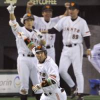 Big moment: Giants slugger Alex Ramirez watches his game-winning, two-run homer leave the yard on Saturday in the eighth inning at Tokyo Dome. | KYODO PHOTO