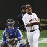 Battering Ram: Yomiuri's Alex Ramirez hits a 'sayonara' home run in the ninth inning to give the Giants a 3-2 win over the Seibu Lions in Game 2 of the Japan Series on Sunday. | KYODO PHOTO