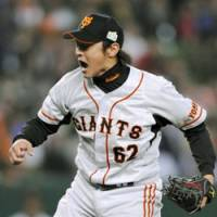 Pleased pitcher: Giants reliever Daisuke Ochi shows more than a hint of satisfaction after striking out Lions slugger Takeya Nakamura in the eighth inning of Game 3 of the Japan Series on Tuesday at Seibu Dome. Yomiuri defeated Seibu 6-4.   KYODO PHOTO