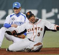 Giant step forward: Giants left fielder Alex Ramirez slides to second base after hitting a double in Yomiuri's 7-3 win over the Seibu Lions in Game 5 of the Japan Series on Thursday. The Giants need just one more win to clinch the series.   KYODO PHOTO