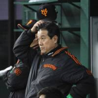 Snug as a bug: Warm jackets, as sported by Giants manager Tatsunori Hara, have been a must at the chilly Seibu Dome this Japan Series. | KYODO PHOTO