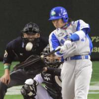 Big outing: Lions veteran Hiroshi Hirao smacks a three-run double in the first inning of Game 6 of the Japan Series on Saturday. He added a solo home run in the fifth to lead Seibu to a 4-1 win over the Yomiuri Giants at Tokyo Dome. | KYODO PHOTO