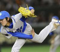 Rising to the occasion: Lions hurler Takayuki Kishi has allowed zero runs against the Yomiuri Giants in 14 2/3 innings in the Japan Series. He's also fanned one or more batters in 13 of those innings while picking up a pair of victories on the mound, helping Seibu force a deciding seventh game on Sunday at Tokyo Dome. | KYODO PHOTO