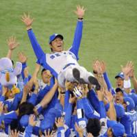 Air time: Seibu Lions' manager Hisanobu Watanabe is given a celebratory toss in the air following his team's win over the Yomiuri Giants in the final game of the Japan Series   KYODO PHOTO