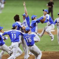 Giant killers: The Seibu Lions celebrate their Japan Series championship after Game 7 on Sunday at Tokyo Dome. The Lions beat the Yomiuri Giants 3-2 in the Series finale. | KYODO PHOTO