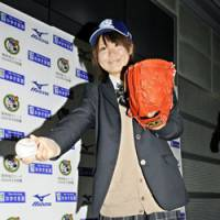 A league of her own: Eri Yoshida's proficiency with the knuckleball has her on track to become Japan's first female professional baseball player.   KYODO PHOTO