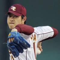 Super season: Tohoku Rakuten ace Hisashi Iwakuma receives the Pacific League's MVP award after going 21-4 in 2008. He finished the season with a league-low 1.87 ERA. | KYODO PHOTO
