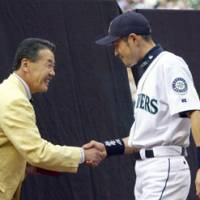 Roadrunner: Yutaka Fukumoto, seen here shaking hands with Ichiro Suzuki in 2003, is Japan's all-time career stolen base leader with 1,065. Fukumoto led the Pacific League in steals every season from 1970-81. | AP PHOTO