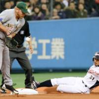 Good form: Japan outfielder Ichiro Suzuki slides into third safely on a single by Atsunori Inaba in the third inning of the WBC exhibition game against Australia on Tuesday at Kyocera Dome. Japan won 8-2. | KYODO PHOTO