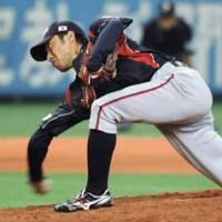 Down under: Shunsuke Watanabe pitches in the sixth inning of Japan's 11-2 win over Australia in an exhibition game at Kyocera Dome in Osaka on Wednesday. | KYODO PHOTO