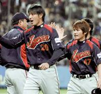 Ready to go: Pitchers Hisashi Iwakuma (20) and Toshiya Sugiuchi (47) helped kick off Japan's title defense on a good note in two exhibitions against Australia in Osaka. | KYODO PHOTO