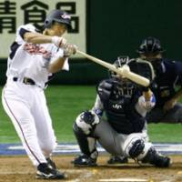 Right on the money: Michihiro Ogasawara smacks a pitch in the fourth inning for an RBI double during Saturday's exhibition contest against the Lions at the Big Egg.   KYODO PHOTO