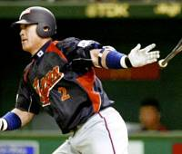 Staying cool: Japan catcher Kenji Johjima is trying to save his energy for the World Baseball Classic by not getting too excited ahead of the first game on Thursday. | AP PHOTO