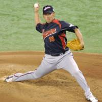 One-sided contest: Japan hurler Daisuke Matsuzaka's team led 8-2 after two innings en route to a 14-2 victory over South Korea in a World Baseball Classic game on Saturday at Tokyo Dome.   KYODO PHOTO
