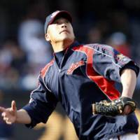 Focused on winning: Japan catcher Kenji Johjima prepares to catch the ball during Saturday's team practice at PETCO Park in San Diego. Japan, the reigning WBC champion, faces Cuba on Sunday. | AP PHOTO