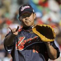 National hero: Japan hurler Daisuke Matsuzaka struck out eight batters in an impressive 86-pitch outing against Cuba on Sunday in the World Baseball Classic.   KYODO PHOTO