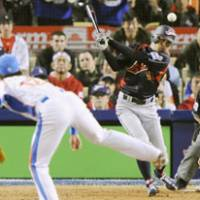 Grace under pressure: Ichiro Suzuki delivers the decisive two-run hit in the top of the 10th inning off South Korea's Lim Chang Yong to give Japan a 5-3 victory in the final of the World Baseball Classic on Monday night in Los Angeles. | KYODO PHOTO