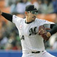 Not done yet: Chiba Lotte reliever Satoru Komiyama notches a victory on Friday against Saitama Seibu at 43 years and 6 months old, renewing his own record for the oldest hurler to post a win in Marines history. The right-hander is the fourth-oldest pitcher to record a win in NPB history. The Marines sank the Lions 10-5. | KYODO PHOTO