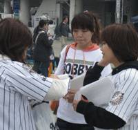 Rallying for a cause: Bobby Valentine supporters get a signature from a fan in support of keeping Valentine as the Chiba Lotte Marines manager next season last Saturday in Chiba. | JASON COSKREY PHOTO